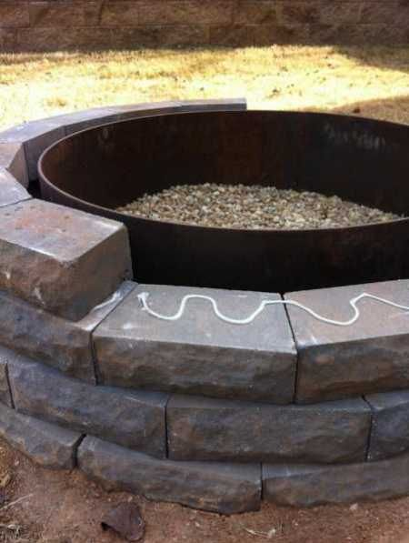 Firepit: Take a look and you'll be surprised how easy it can be for you to make one for yourself.