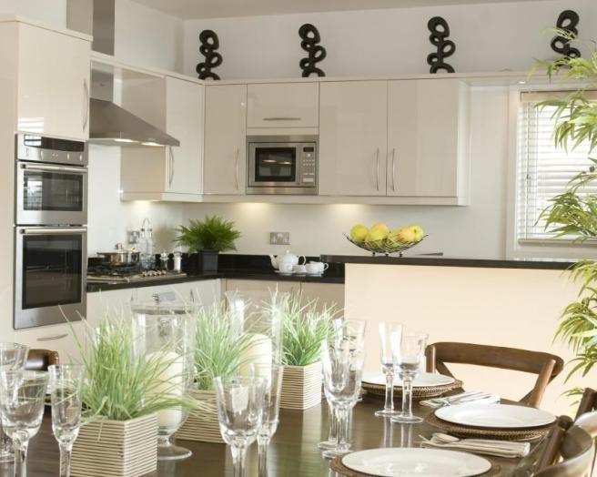 photo of open plan beige white kitchen