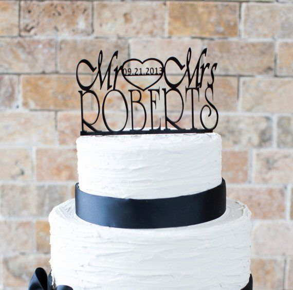 Personalised cake topper - see more ideas at http://themerrybride.org/2014/09/06/ideas-for-personalising-your-wedding/