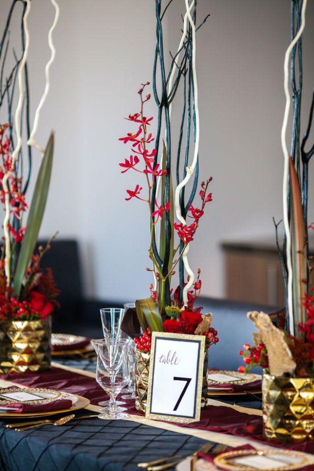 Glamorous red, black, and gold wedding tablescape  (Ashley Kidder Wedding Photographer)