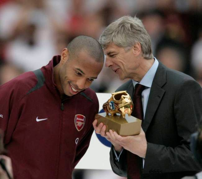 Wenger Presents Henry with Another Award.