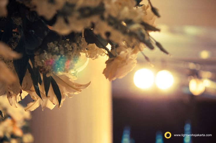 Beautiful flower with lighting in the background for your wedding day. Decoration by Lotus and lighting by Lightworks  www.lightworksjakarta.com