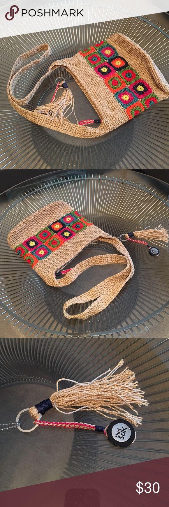 NWOT Sak purse NWOT Sak purse. Beautiful Sak woven purse with zip closure. Comes with matching keyfob. Bag measures 9h x 10l x 1w The Sak Bags