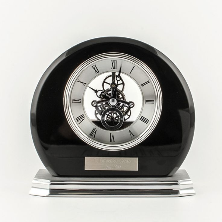 Skeleton Clock Blk Round with Piano Finish - This clock design is sure to be a welcomed addition to any home or office space. The shiny black piano finish of the clock body combined with the skeleton clock face is a unique pairing. We can add a silver engraving plate to complete the gift.