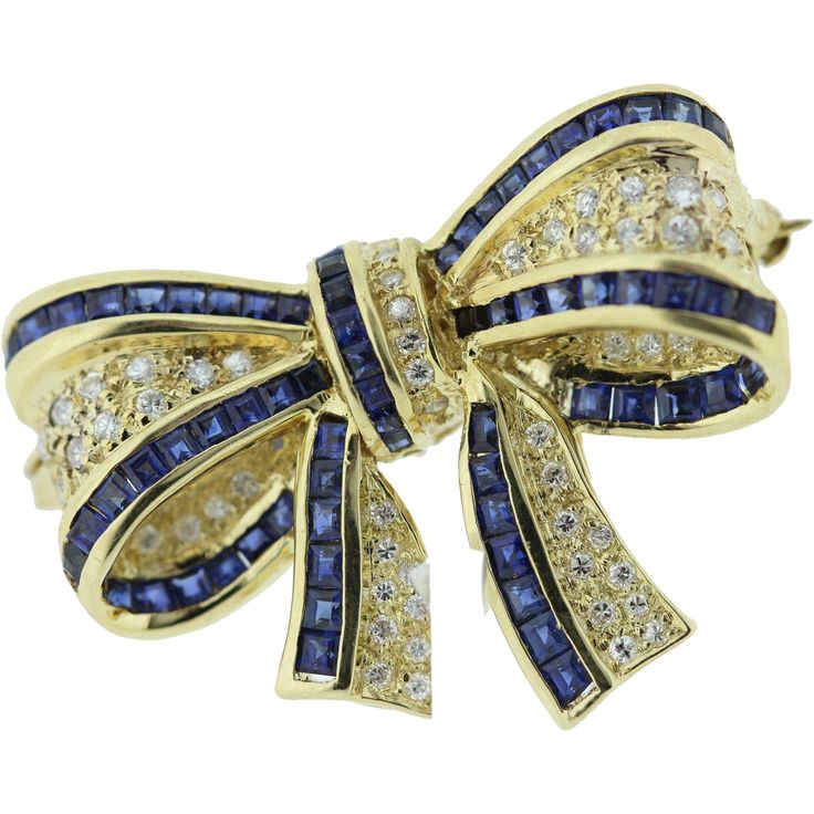 18 K Yellow Gold Bow Brooch with Diamonds and Blue Sapphires.