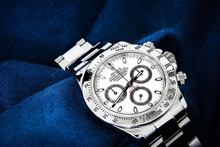 Stainless Steel Rolex Daytona Wristwatch with White Dial.
