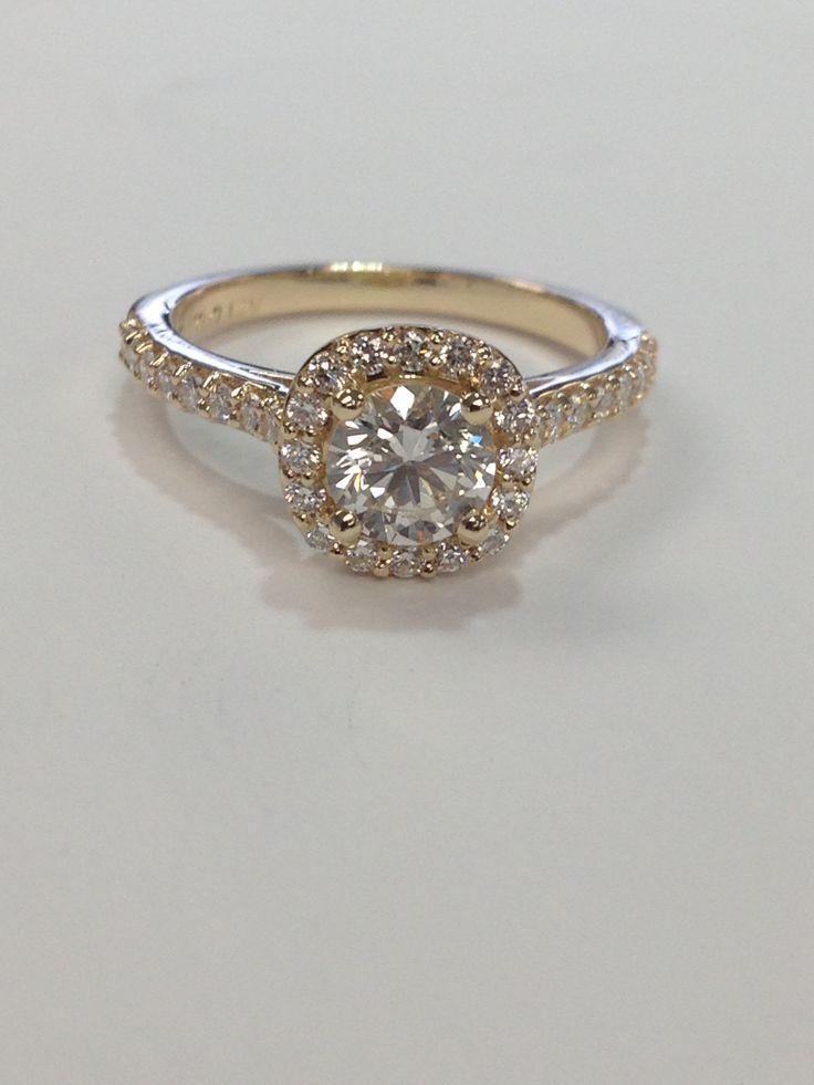 Yellow gold cushion shape halo with round brilliant cut diamond in centre.  www.abrahamsjewellery.com