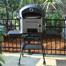 Make gourmet brick oven pizzas in 3 minutes or less, in your own backyard. Blackstone Propane Gas Outdoor Pizza Oven On Cart #BBQGuys