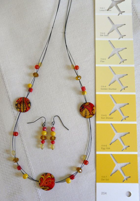 These printed shell beads of yellow red and black by PlaneNSimple