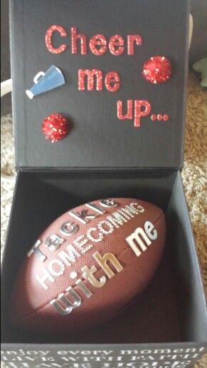 Football player asking cheerleader to homecoming.