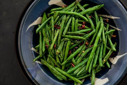 Sichuan Style Stir-Fried Chinese Long Beans Recipe Side Dishes with yardlong beans, peanut oil, dried chile, szechwan peppercorns, salt, sugar, sesame oil, soy sauce