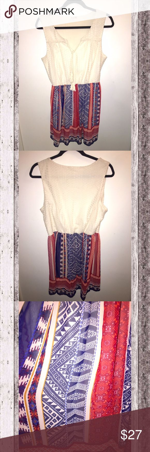 Tribal Print Dress Beautiful Tribal Print Dress! Perfect to add to your spring collection🌞 Features sheer blue, red & orange tribal print. Upper part of dress is white lace with attached dangle strings. Stretchy elastic cinched waist. Fully lined. Very comfortable & flowy. Size Large.                                                                              ✨Top Rated Seller✨ Fast Shipper👍🏻 10% off 3+ bundle💖 AUW Dresses Midi