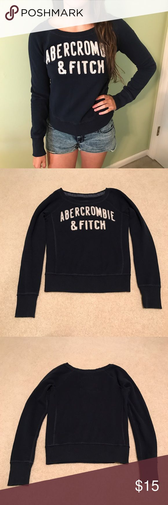 Abercrombie and Fitch Crewneck Sweatshirt Size S Abercrombie and Fitch navy crewneck sweatshirt size S. Light signs of wear but in great condition. Perfect with leggings or jeans! Abercrombie & Fitch Sweaters Crew & Scoop Necks