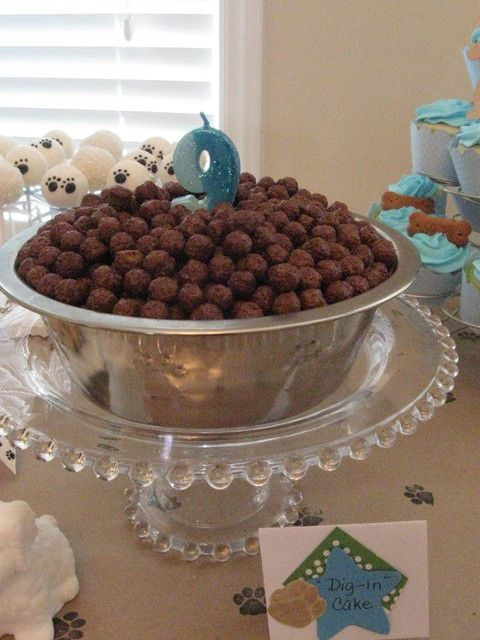 Puppy chow cake, cake is underneath with Cocoa Puffs on top
