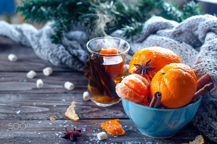 Tangerine in scarf over wooden background - Tangerine in scarf over wooden background with snow and leaf.