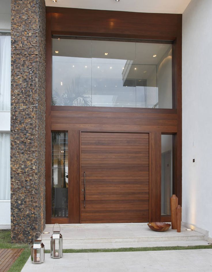 Las 25 mejores ideas sobre fachadas de casas modernas en for Puertas principales modernas de madera