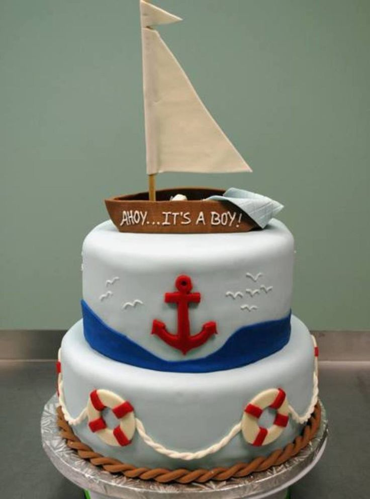 Nautical Baby Shower With A Sleeping Baby Hidden In The Boat. Nautical baby shower cake inspiration and ideas