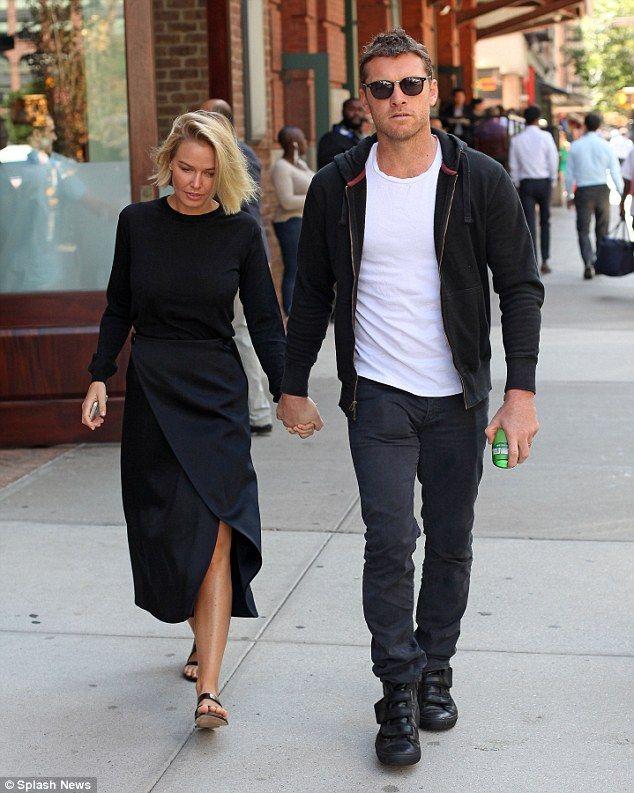 Lara Bingle and Sam Worthington - In New York. (September 2014)