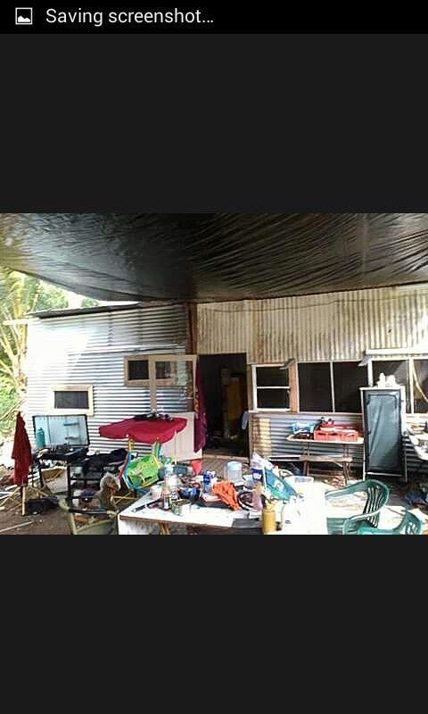 Three bedrooms n a pallet wood deck floor....solar panels n battery storage.....cheap living...