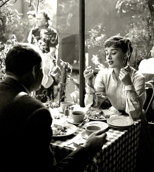 Audrey Hepburn with dining companion in Mexico c.1953  From photos by Earl Theisen for Look magazine.