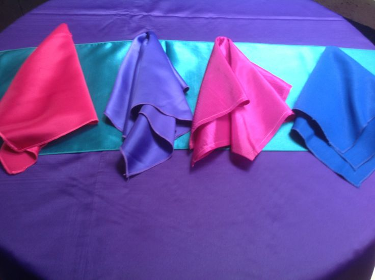 Hot Pink, Purple, Magenta And Royal Blue Napkins Over Teal Runner And  Purple Satin