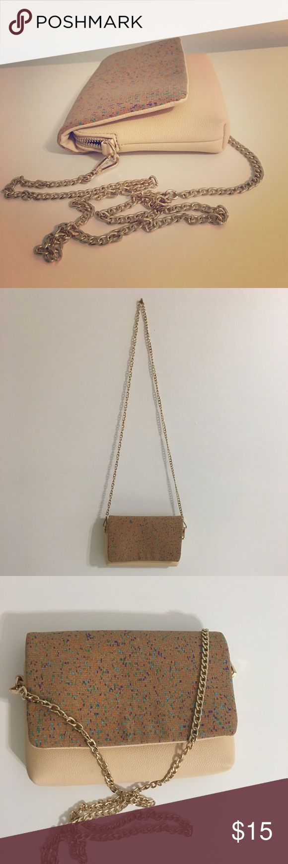 Beige crossover bag with gold chain This bag is used in a very good condition, barely used. It's beige with gold chain. Bags Crossbody Bags