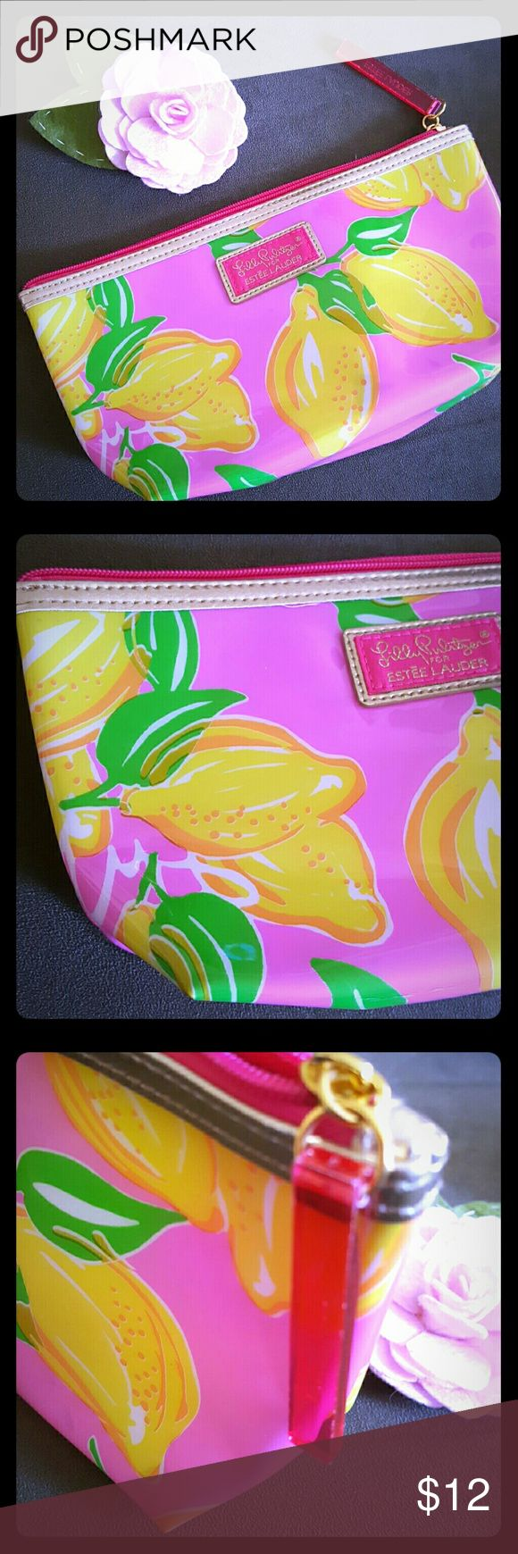"🍋 Lilly Pulitzer for Estee Lauder cosmetic bag 🍋 Adorable pink bag with bright yellow lemons and gold detailing. Sturdy, plastic coating makes bag easy to clean! Measures 9.5"" x 5"" x 3"" In GUC.  BUNDLE & SAVE  POSH RECOMMENDED SELLER Lilly Pulitzer Bags Cosmetic Bags & Cases"