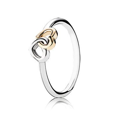 Two hand-finished, interlocking hearts in sterling silver and 14K gold beat as one on this gorgeous, two-tone ring by PANDORA. It is a timeless, must-have addition to any collection and a great gift option for any woman. #PANDORAring