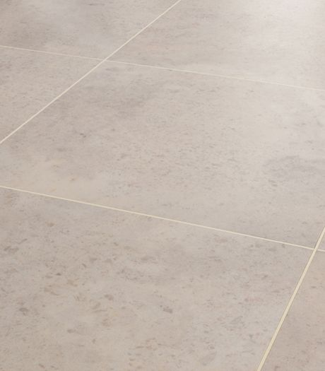 Karndean Opus Nimbus SP113 vinyl flooring has a clean, smooth stone effect almost parallel to a porcelain finish. However the warm grey tone and gentle mottle pattern create a visual texture that has more interest than your average cool grey stone. The strip displayed between the tiles is AF06 3mm design strip.