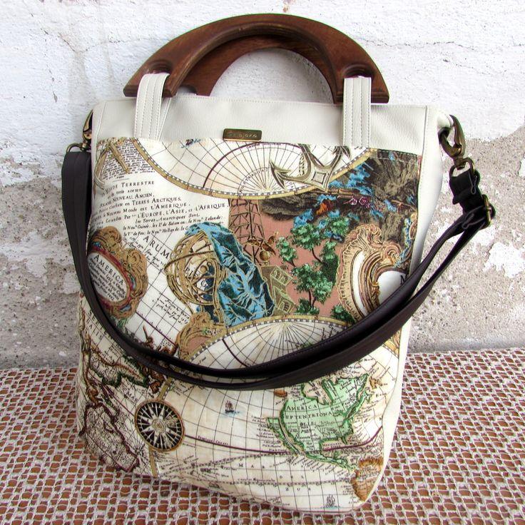 Marina no.19-mapa světa ušila jsem pro vás jednoduchou elegantní tašku,k nošení v ruce i přes rameno ušito z krásné bavlněné látky s oblíbeným motivem mapy světa v krémové doplněno o světlou koženku--zadní díl tašku zdobí dřevěná ucha vyrobena v malé truhlářské dílně a namořená jednoduchý tvar a střih bavlněný díl pevně vyztužený uvnitř bavlněná ...