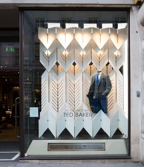 AY Architects used interlocking panels to form freestanding screens at Moss Bros, creating a three-dimensional herringbone effect.