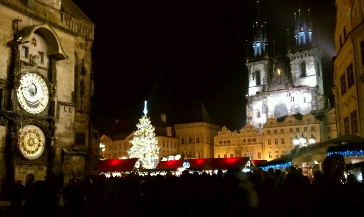 Prague Christmas Night Market. I took this photo in front of Hotel U Prince #christmas #czechrepublic #market #belltower