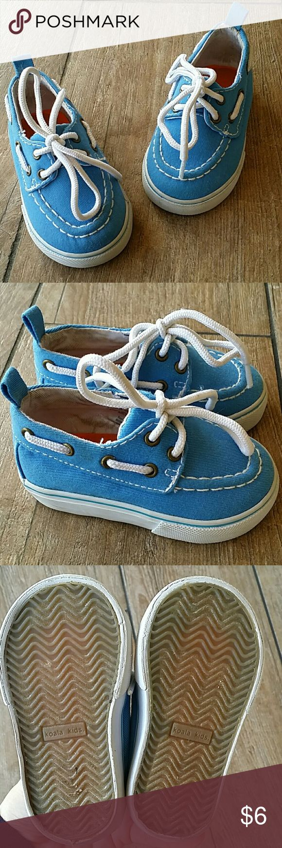 LIGHT BLUE BOAT SHOES Light blue with white laces Pull tab on back to get on I don't think he ever wore them, bottoms look brand new. Inside wear could be inside trying on Smoke few home Koala Kids Shoes