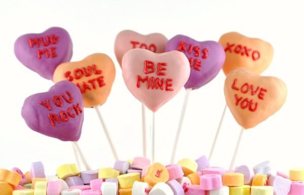 Conversation Hearts Cake Pops for Valentine's Day ~ Red velvet cake pops with a cream cheese frosting shaped into conversation heart candies for Valentine's Day.