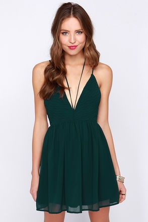 Happy days and wild nights need a dress as divine as the Strappy Go Lucky Forest Green Dress! A pair of skinny spaghetti straps support a sassy triangle bodice in a woven poly fabric, boasting a pleated bodice that ripples along side a plunging V-neckline into a set-in waist. A second set of straps travels from the bodice to tie around the neck for a chic halter effect, while a low draping back and short flaring skirt finish this sultry look! Hidden back zipper/clasp. Lined in green stretch…