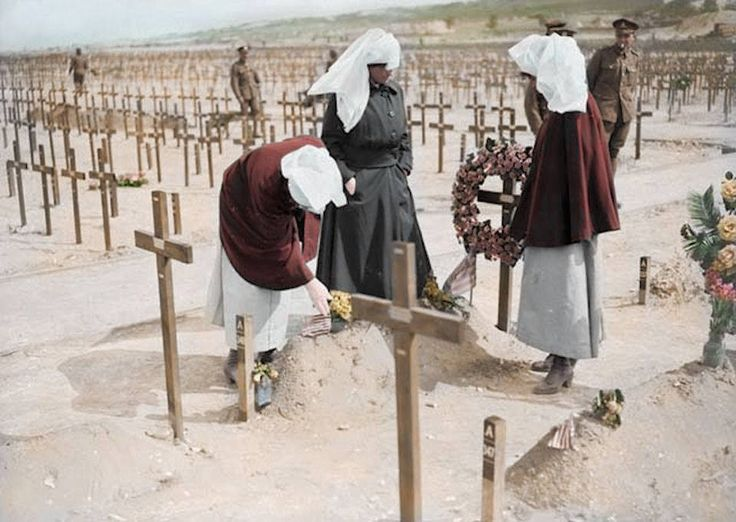 Nurses attending the grave of fellow nurse Margaret Lowe, who served as a Nursing Sister in the Canadian Army Medical Corps during World War One.