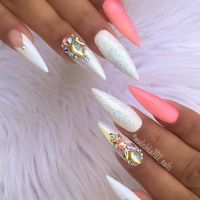 Pointed bling nails.