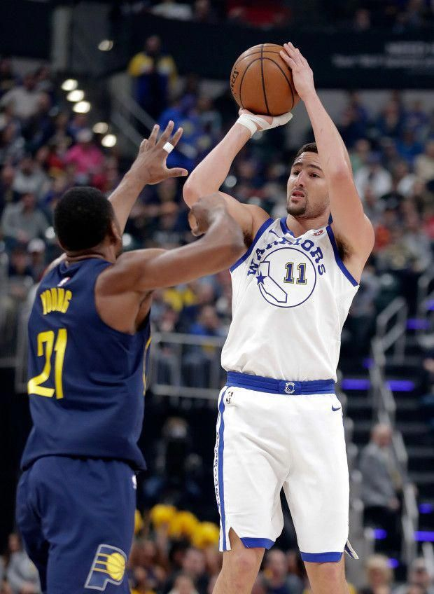 f1f94a21773c Golden State Warriors guard Klay Thompson (11) shoots over Indiana Pacers  forward Thaddeus Young (21) during the first half of an NBA basketball game  in ...