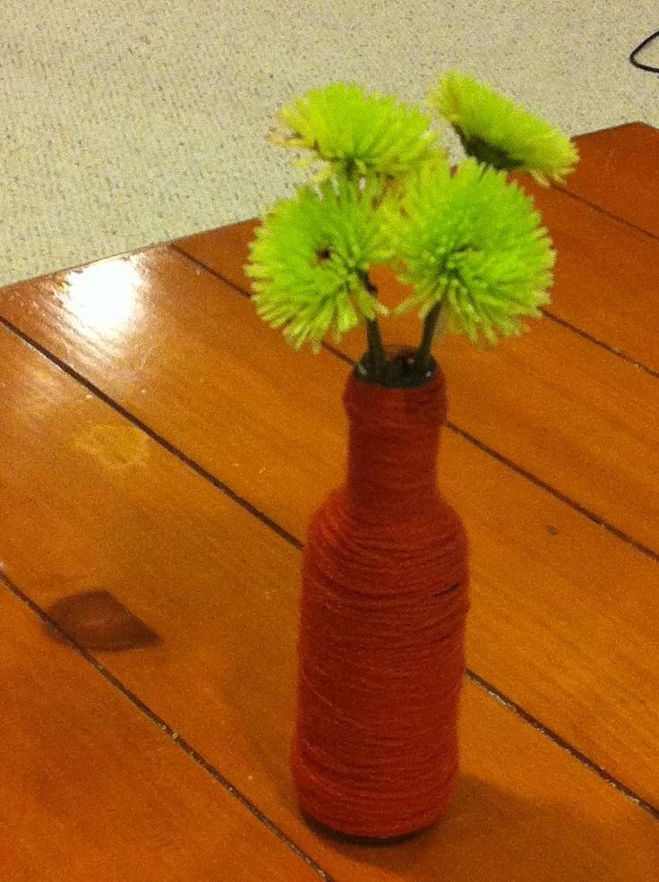 Yarn-wrapped (mini) wine bottle bud vase.