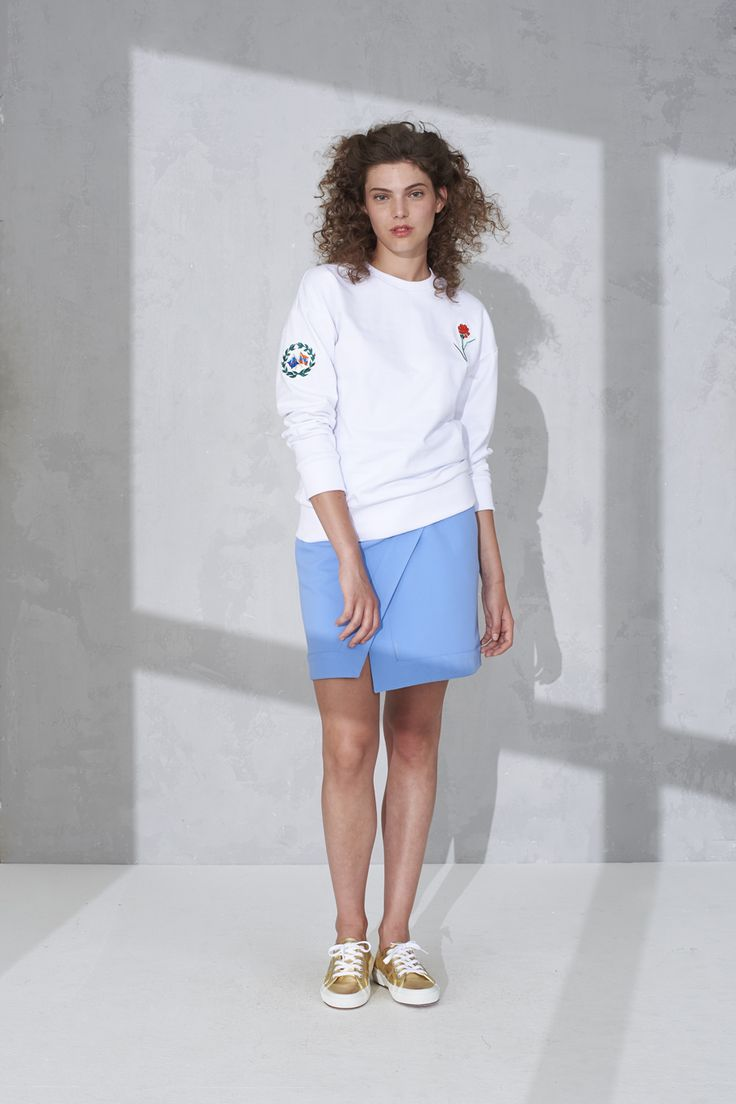 Drop shoulder sweater with badge detail and overlap mini skirt