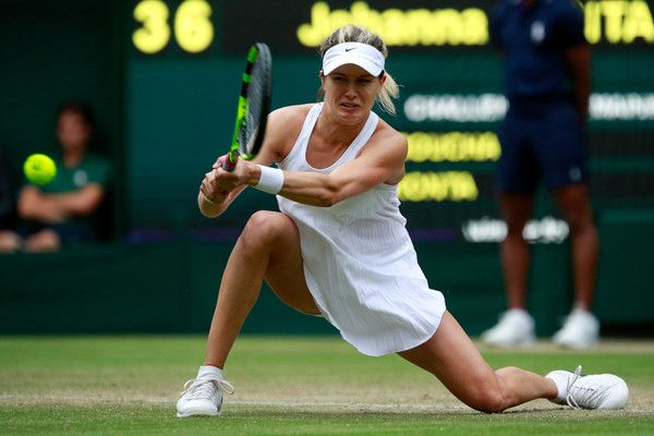 Eugenie Bouchard Photos - Eugenie Bouchard of Canada plays a backhand during the Ladies Singles second round match against Johanna Konta of Great Britain on day four of the Wimbledon Lawn Tennis Championships at the All England Lawn Tennis and Croquet Club on June 30, 2016 in London, England. - Day Four: The Championships - Wimbledon 2016