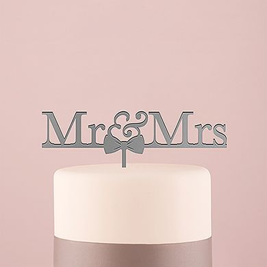 Mr And Mrs Bow Tie Acrylic Cake Topper Metallic - Silver. Love doesn't get much cuter than this. This acrylic cake topper features Mr & Mrs text with an adorable bow tie for the finishing touch. Completely food safe, simply insert into the top tier of your cake for a unique and sweet addition.