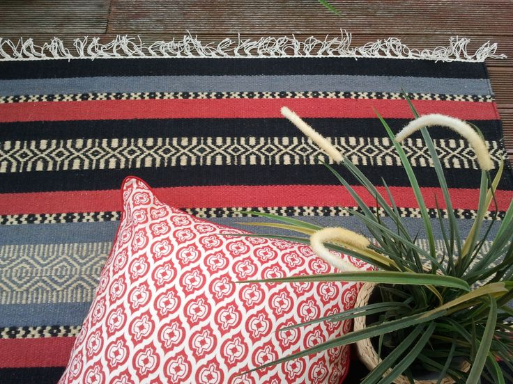 A bit South American or a bit eastern...you decide, featured one of our handwoven cotton dhurries with our linen handscreenprinted cushion with a little bit of green thrown in there to balance the reds & greys....I'm loving this shot available at www.shakiraaz.com.au