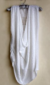 Free knitting pattern for a a delicate spring top. Layer it with your favorite tank tops for the perfect spring outfit.