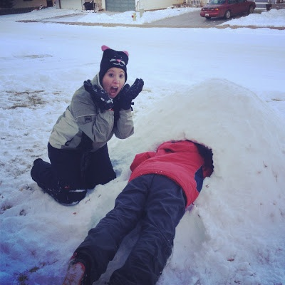 "Winter fun - build a quincy in your yard.  Pile the snow up, pack it down as hard as you can, wet it with a light mist (we used a hose), and let it freeze.  The next day, hollow it out - reverse igloo and so much fun for kids!  Find out more at ""Down the Wrabbit Hole - The Travel Bucket List"". Click the image for the blog post."