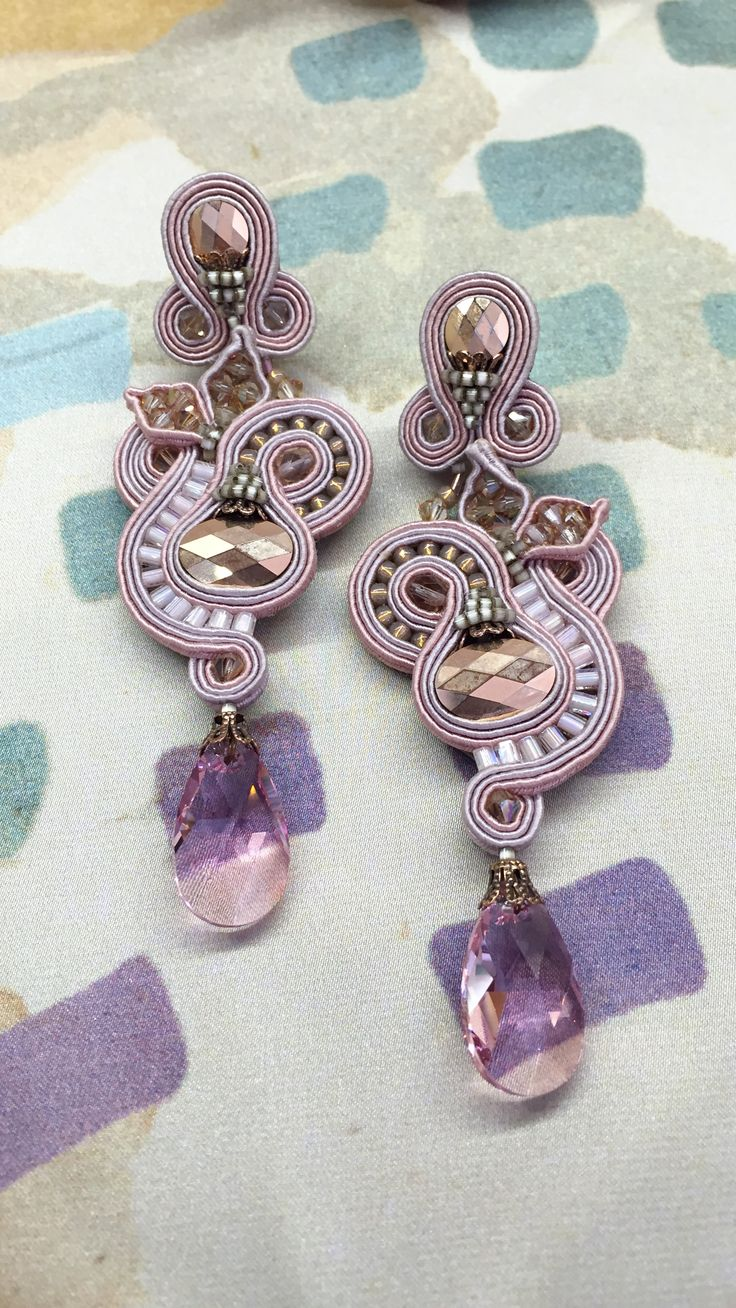 Top up your look with this elegant pair of barely there pink earrings…