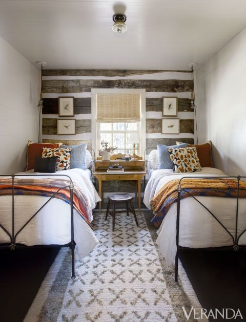 Beds, Cathouse Antique Iron Beds; linens, Matteo; ceiling light, the Urban Electric Co.; rug, the Natural Carpet.