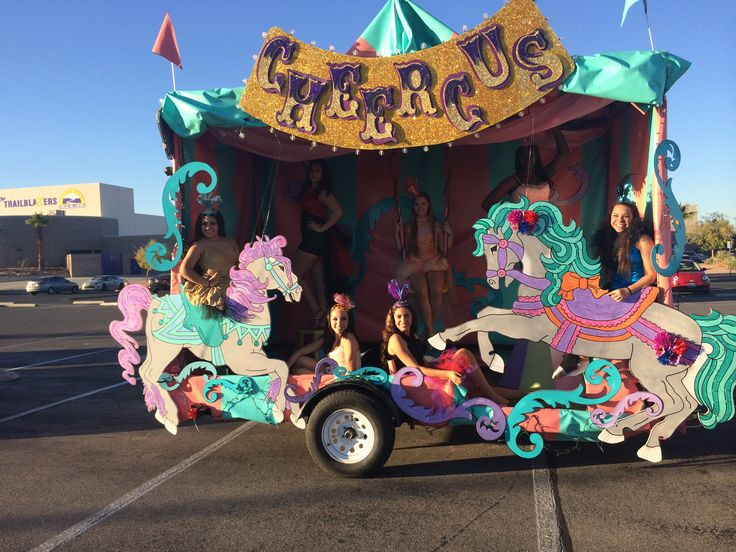 Magalie Sarnataro's props  Banner, curlicues and Carrousel horses made out of foam core and paint, glitter Homecoming parade float
