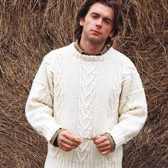 Knit this truly classic chunky jumper design for a man who deserves it, with our free Aran jumper knitting pattern.