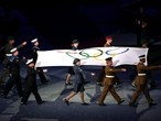 British military carry the Olympic Flag